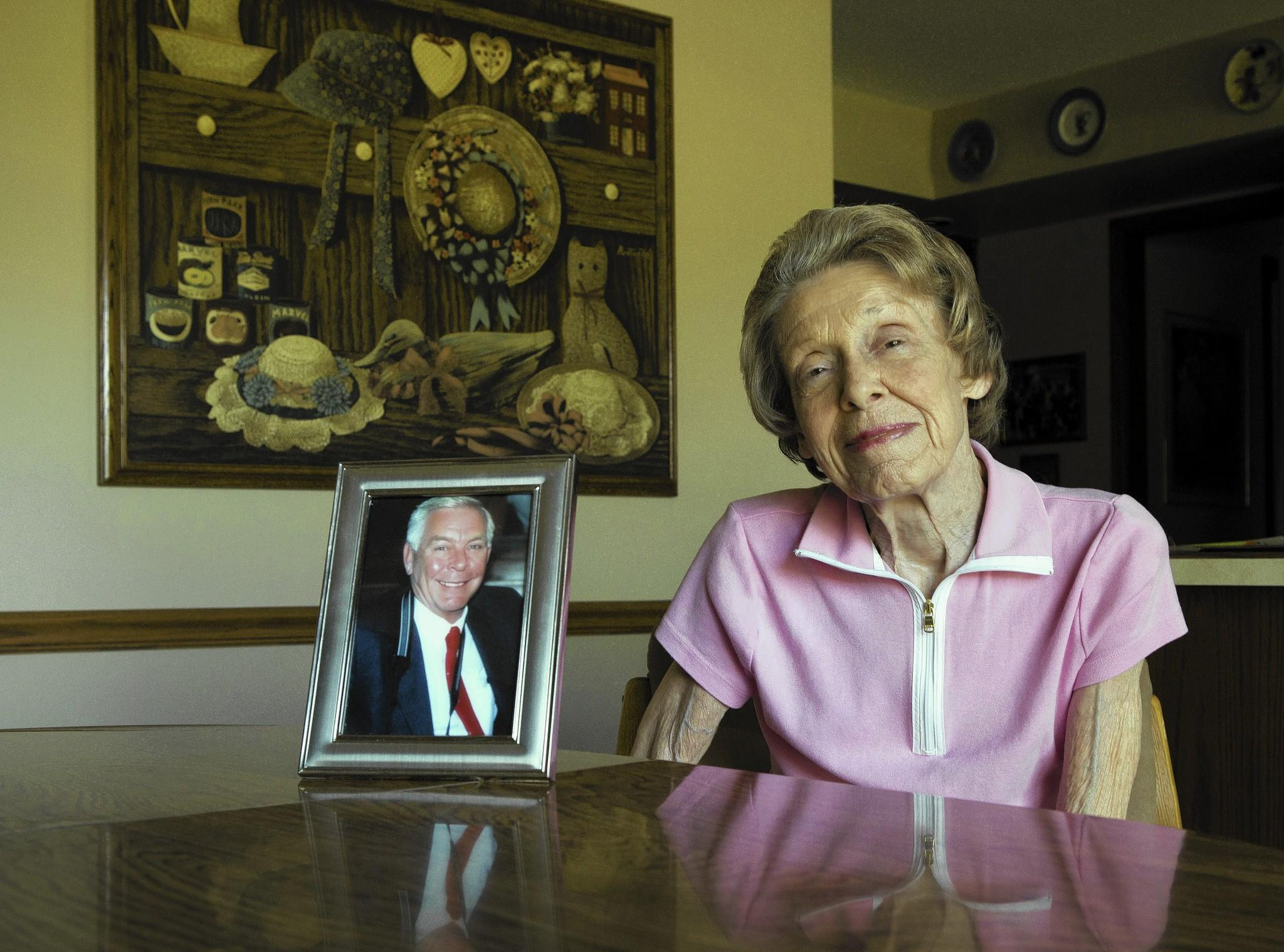 In August, Joan Ezell, 79, shows a photo of her late husband, Jack, who may have given money that's in a state unclaimed property fund. She had been seeking the funds since 2012, but she died this month before the check arrived.