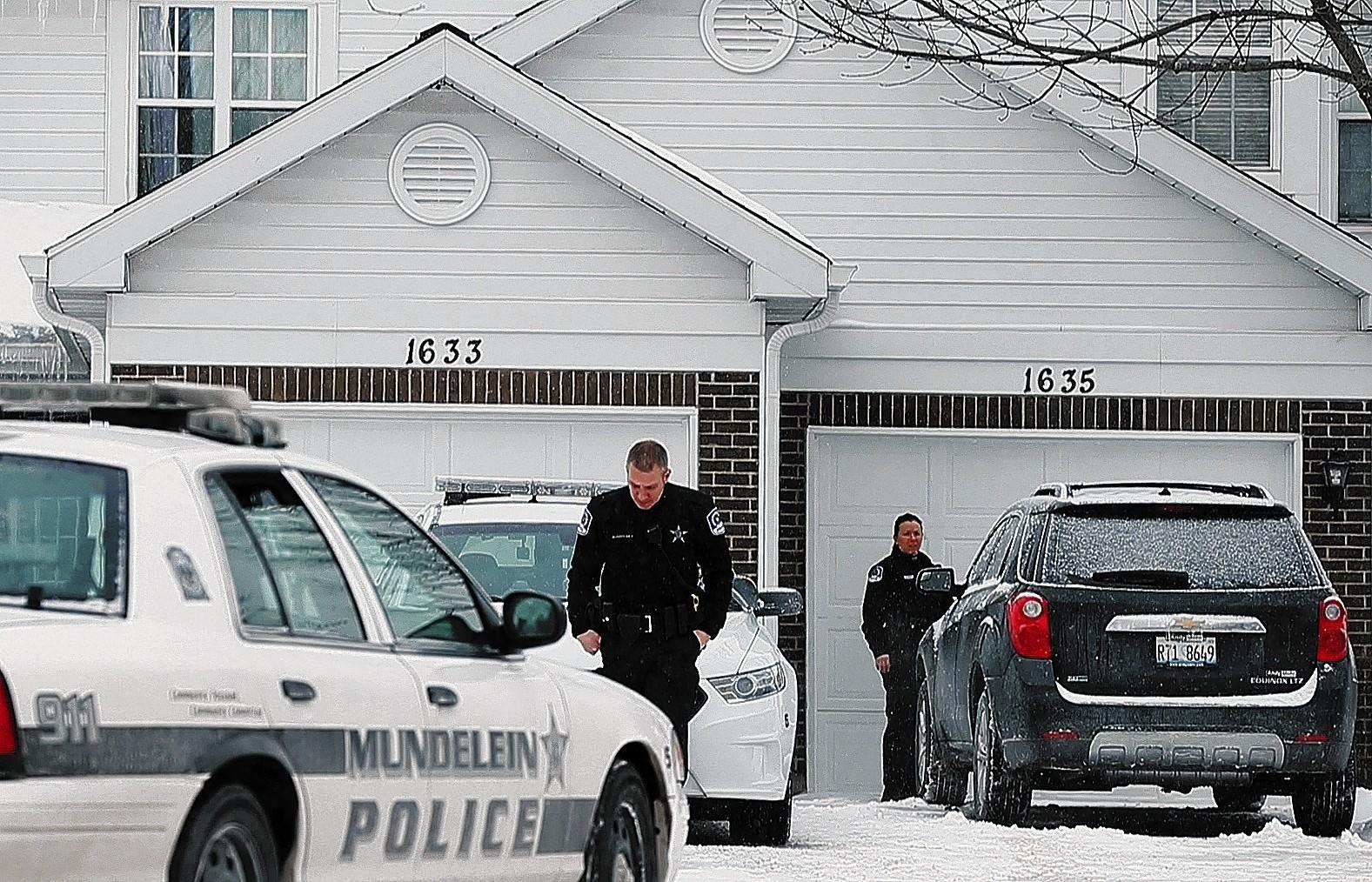 Mundelein police work Wednesday at the home where a girl identified as Dora Betancourt, 11, was killed Tuesday.