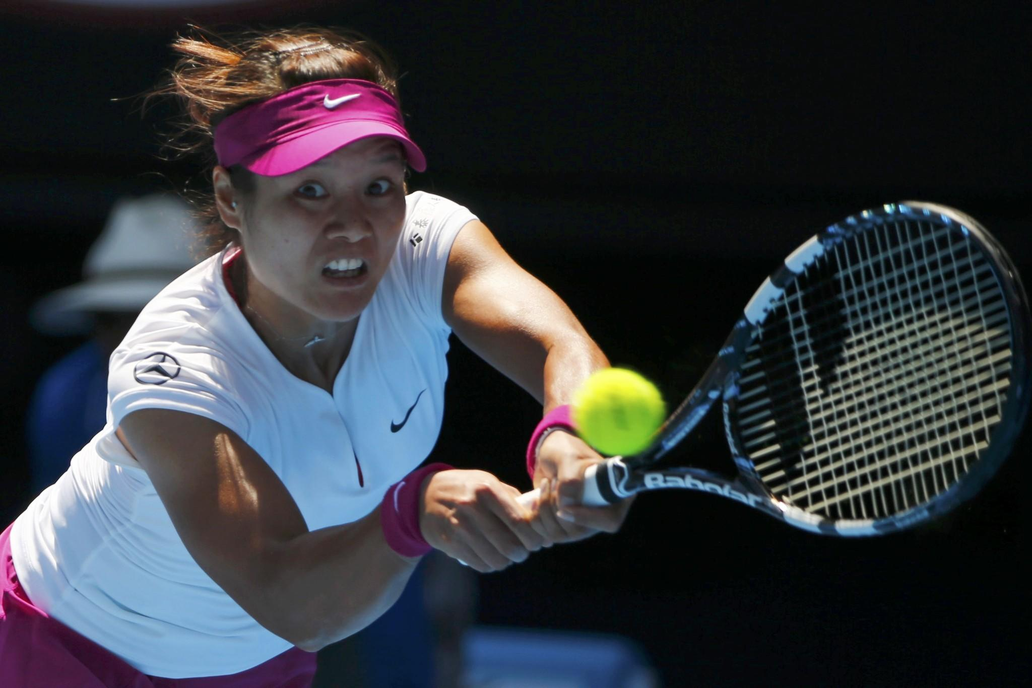 Li Na hits a return to Eugenie Bouchard during their semifinal match at the Australian Open.
