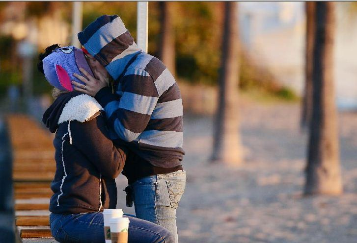 Tracy Bailey, left, and Abigail Pandiscia, both of Ft. Lauderdale, keep each other warm as they watch the sunrise on Ft. Lauderdale beach, Wednesday, Jan 22, 2014