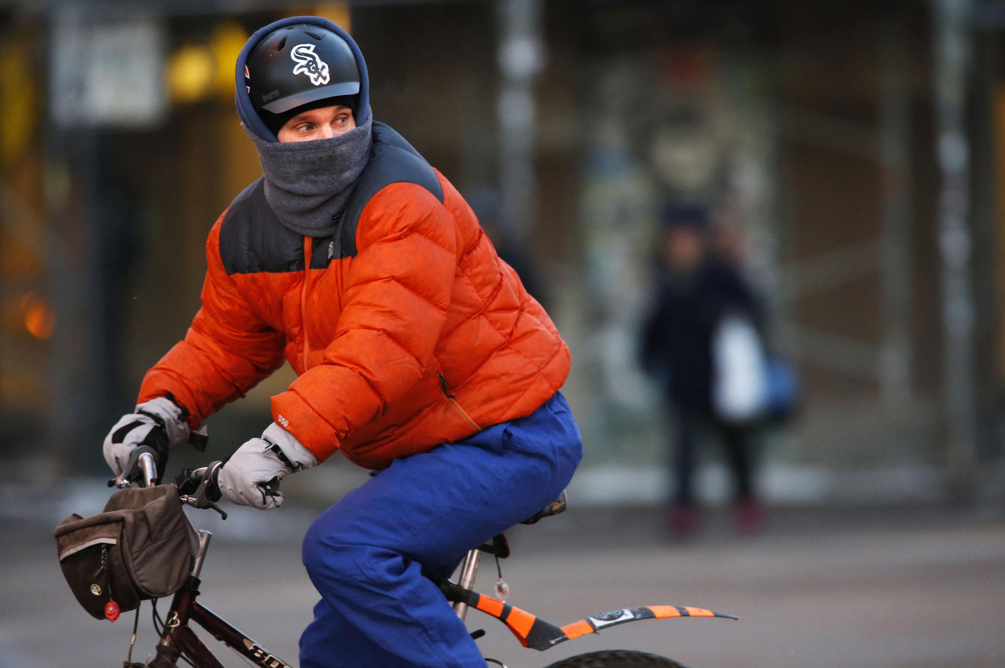 A bicyclist rides southbound in the brutal cold on North Milwaukee Avenue at West North Avenue in Chicago's Wicker Park neighborhood.