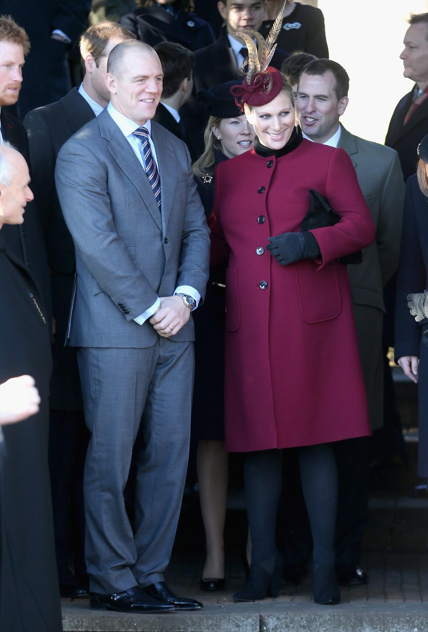 Zara Phillips and Mike Tindall leave the Christmas Day service at Sandringham on December 25, 2013 in King's Lynn, England.