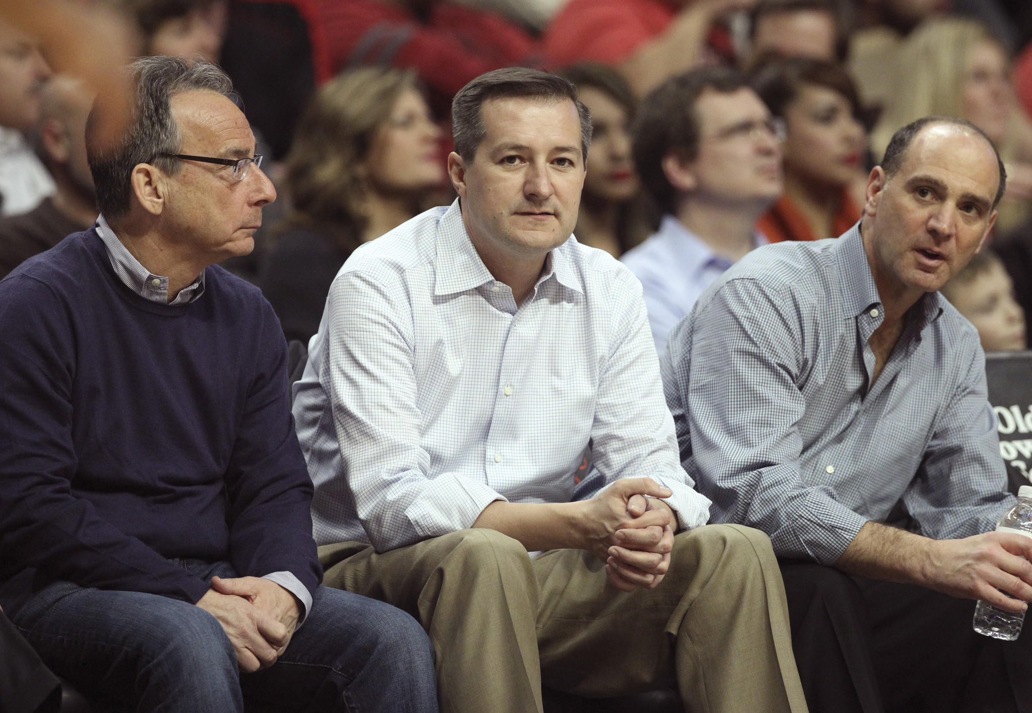 Tom Ricketts (center), owner and CEO of the Chicago Cubs, sitting court side at the game between the Chicago Bulls and the Washington Wizards at the United Center last week.