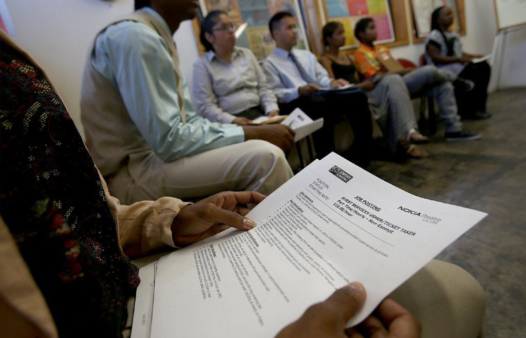 Job seekers prepare to interview for part-time job opportunities at a training center in South Los Angeles.