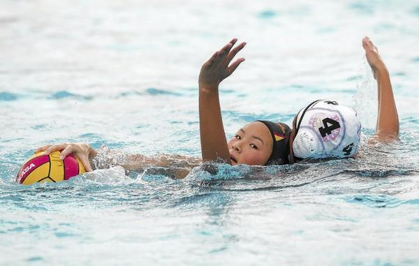 Segerstrom High's Nathania Cuevas plays defense against Ocean View's Elena Isogawa.