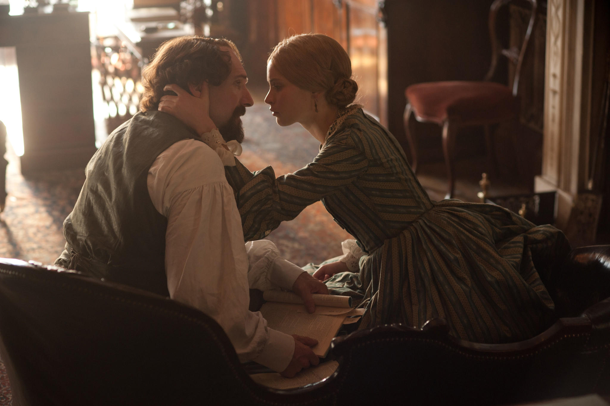 """Ralph Fiennes as Charles Dickens and Felicity Jones as Nelly Ternan in the film """"The Invisible Woman."""""""