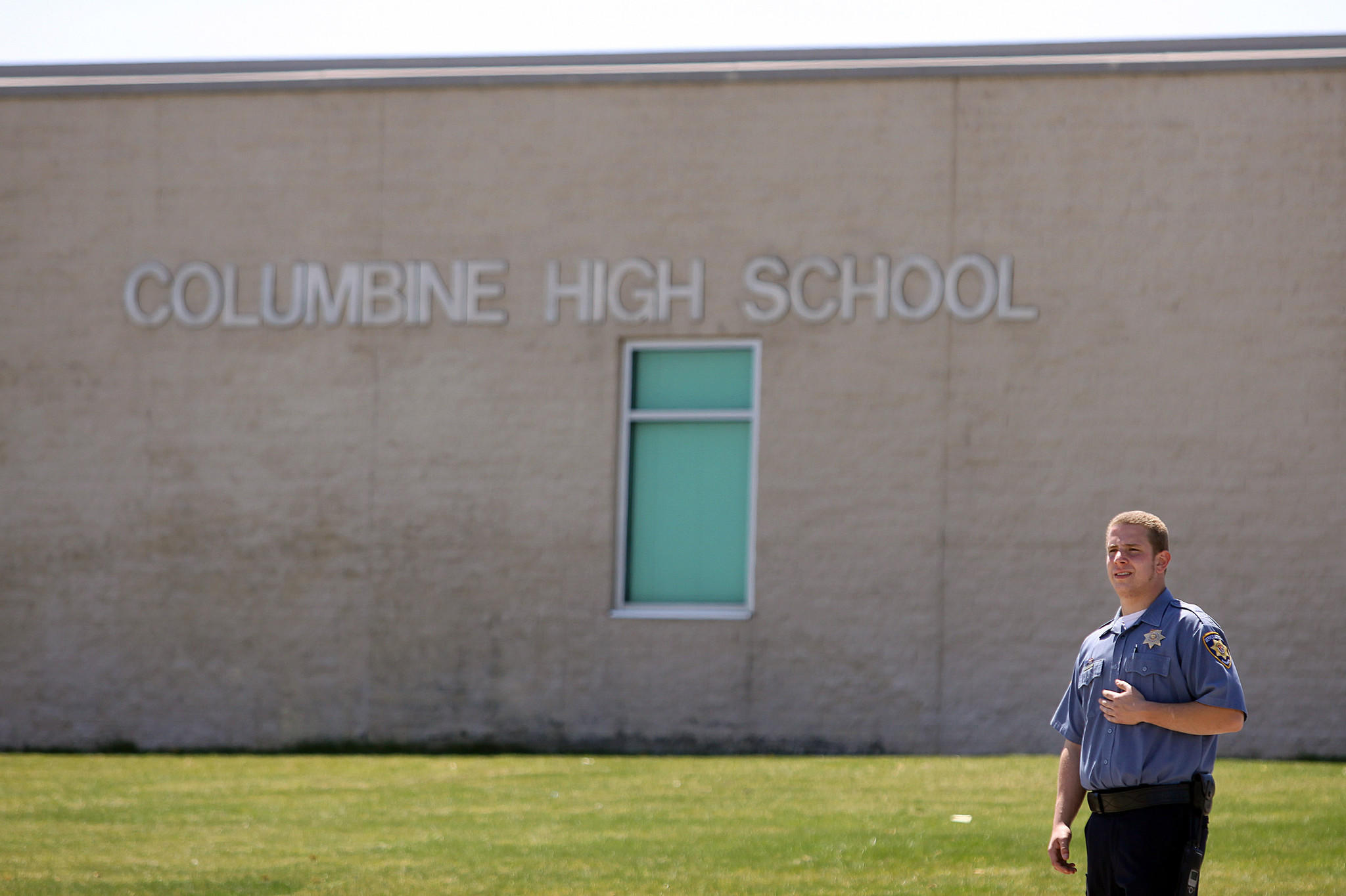 A Jefferson County Schools security officer stands guard at the entrance to Columbine High School on the ten-year anniversary of the Columbine High School shootings in 2009.