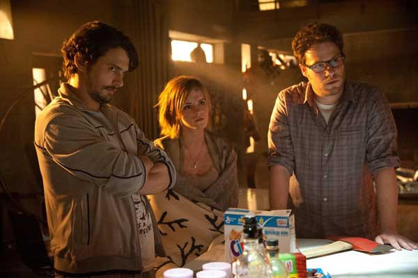 "James Franco, left, Emma Watson and Seth Rogan in ""This Is The End."""