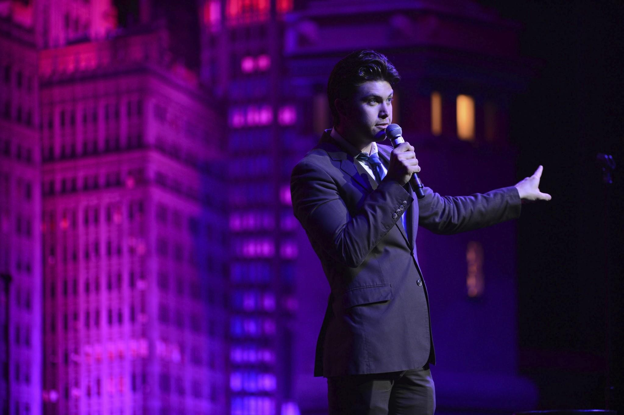 Colin Jost performs onstage at The Chicago Theatre.