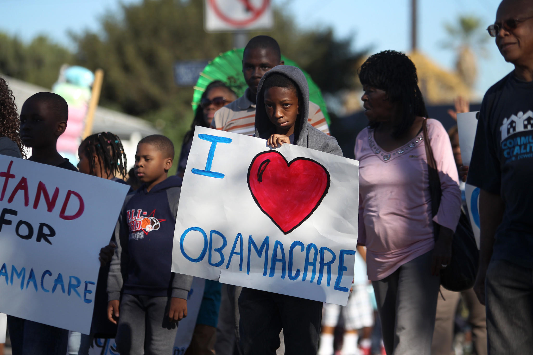 Supporters of the Affordable Care Act (ACA) march in the 29th annual Kingdom Day Parade on Jan. 20 in Los Angeles.