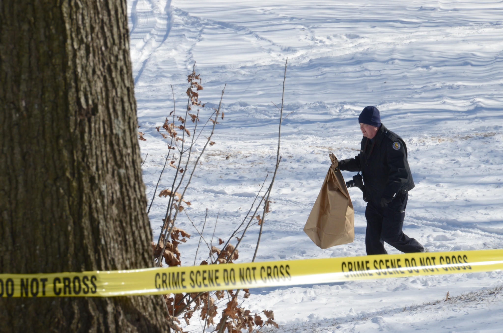 An investigator works at a crime scene at the Bay Hills Golf Club in Arnold Wednesday morning, where Anne Arundel police say a woman's body was found by a man who was walking his dog. The woman's identity and the circumstances of her death had not been determined.