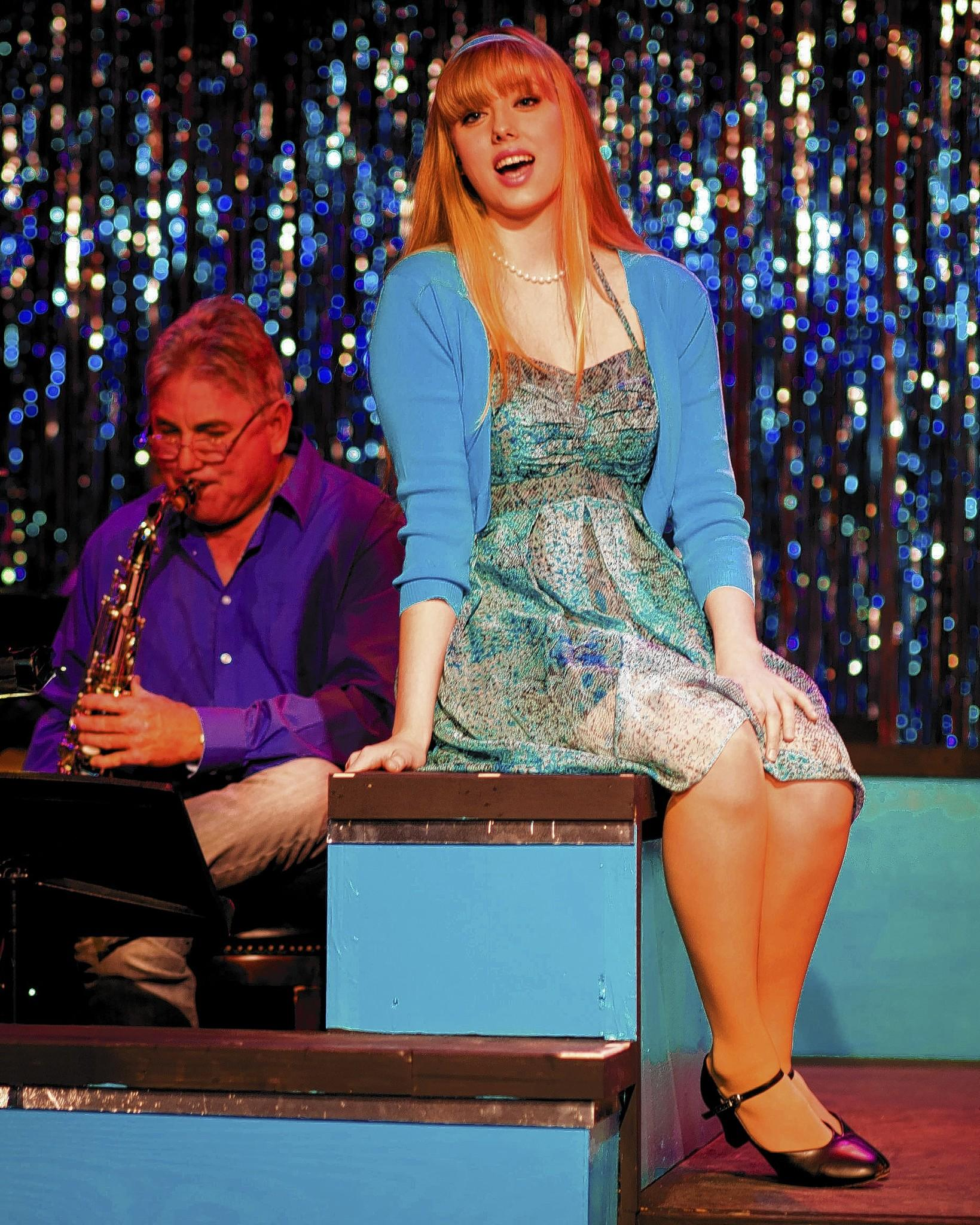 "Savannah Rucks, right, and Gary Dean on saxaphone, in the IceHouse Theatre production of ""Smokey Joe's Cafe."""