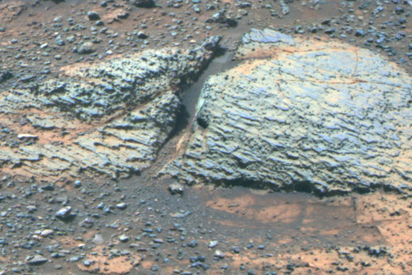 Colors are adjusted in this image to show fine-scale layering in the Whitewater Lake area of Mars. Layers are typically several millimeters thick.