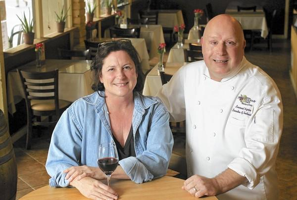 Nancy Milby, left, the executive director and founder, and Laurent Brazier, the executive chef instructor and catering director, pose for a portrait at Laguna Culinary Arts in Laguna Beach on Wednesday. Laguna Culinary Arts has been a staple in Laguna Canyon since the early 2000s. The business will relocate to Costa Mesa.