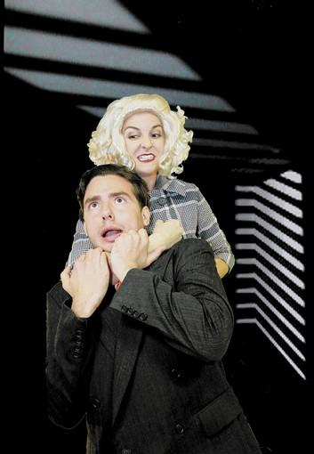 "In ""The 39 Steps,"" Anabella (Mary Jeanes) warns Richard Hannay (Robert Spellman) that, ""These men will stick at nothing!"""