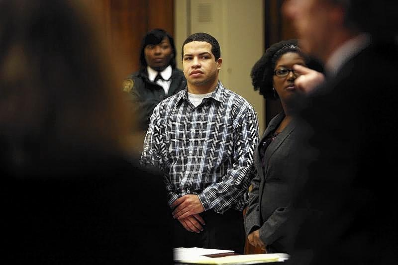 Eric Rivera, Jr. stands as the jury enters the courtroom during closing arguments of the Sean Taylor murder trial in Miami.