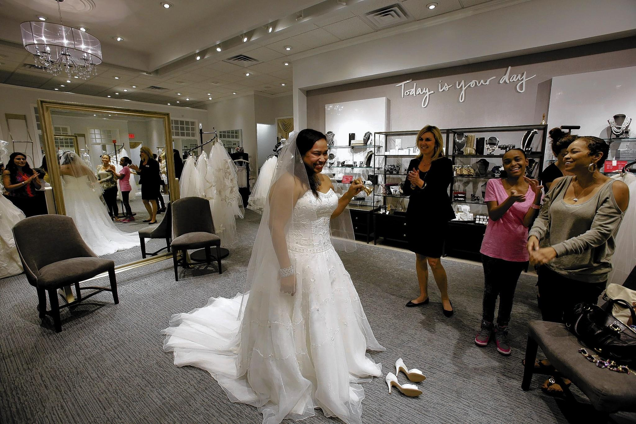 Davids bridal believes new upscale store will be more engaging bride to be tomi dorsey tries on a wedding gown at davids bridal new ombrellifo Image collections