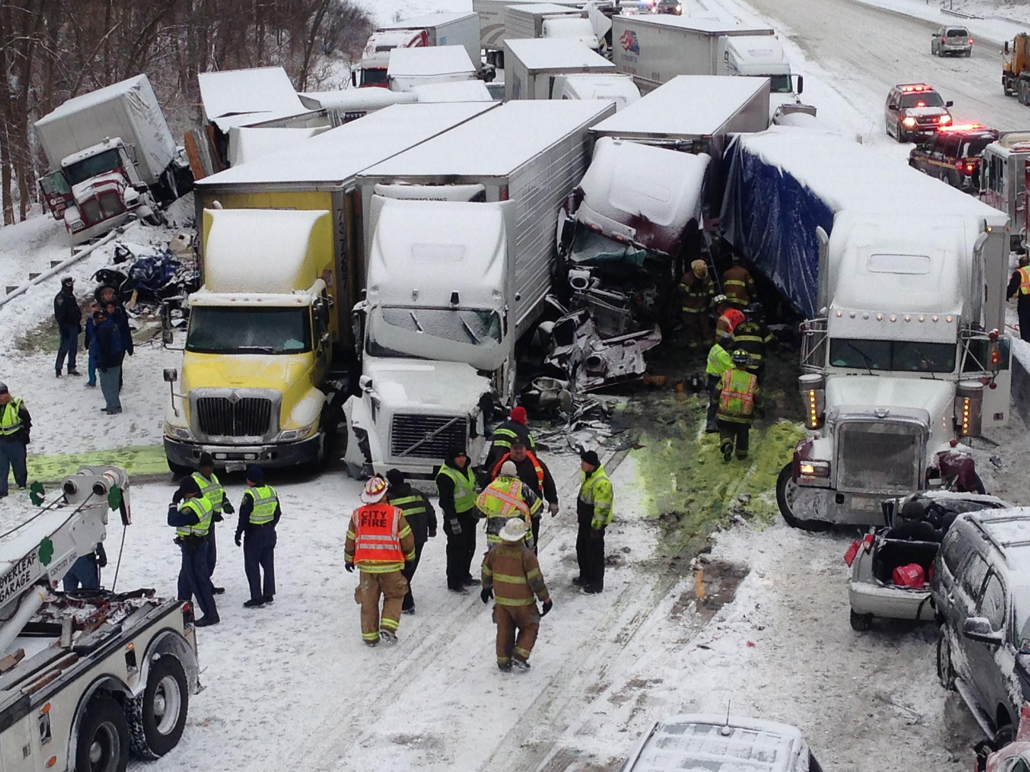 Authorities investigate a multi-vehicle accident on I-94 east of State Road 49 near Chesterton, Ind. Three people died and at least 20 were injured.