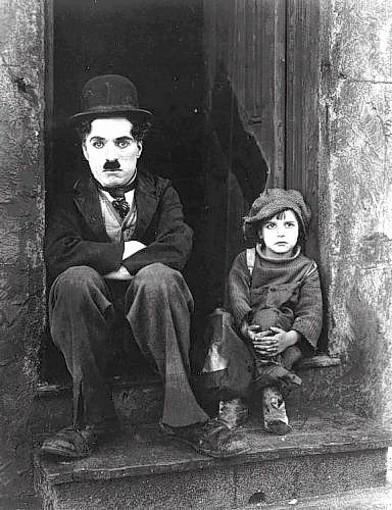 "Charlie Chaplin and Jackie Coogan in ""The Kid,"" 1921."