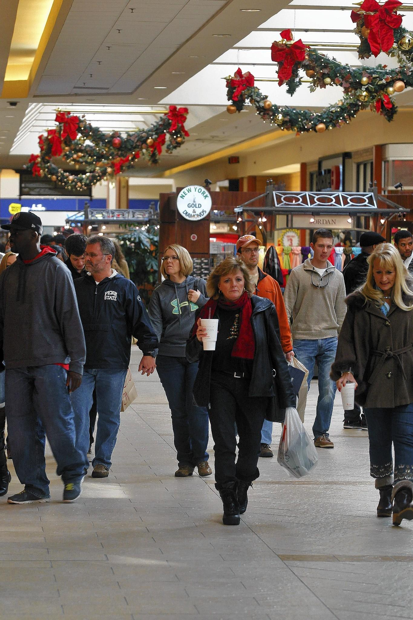Hoping to catch a deal, shoppers hit Patrick Henry Mall in Newport News in December.