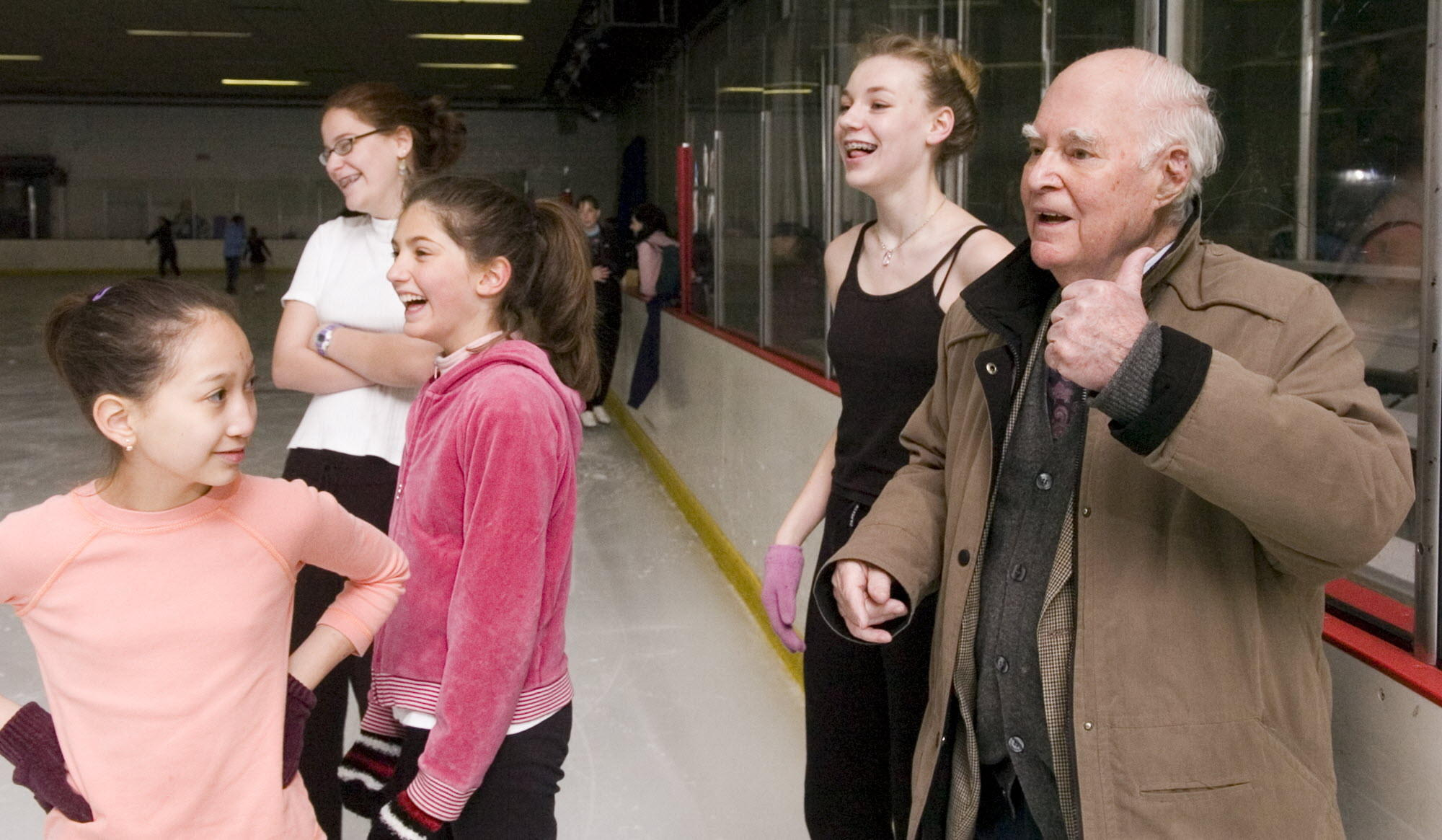 Robert Ogilvie, right, teaches footwork during a figure skating class in April 2006. Ogilvie, 97, died Nov. 18, and a memorial service will be held for him Friday.