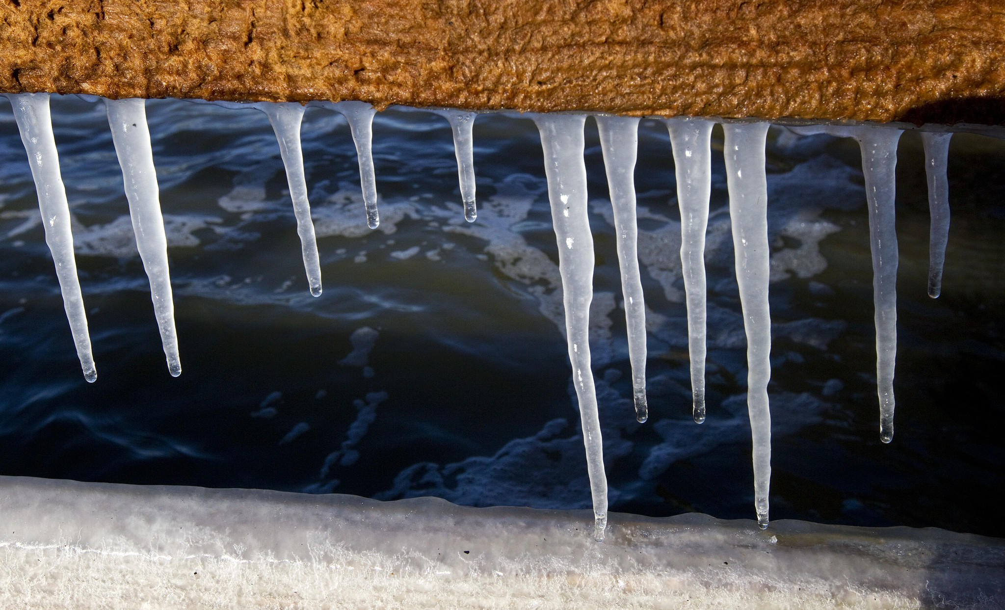 Icicles hang from the Hilton Pier as temperatures hover in the mid-20s on Friday morning in Newport News.