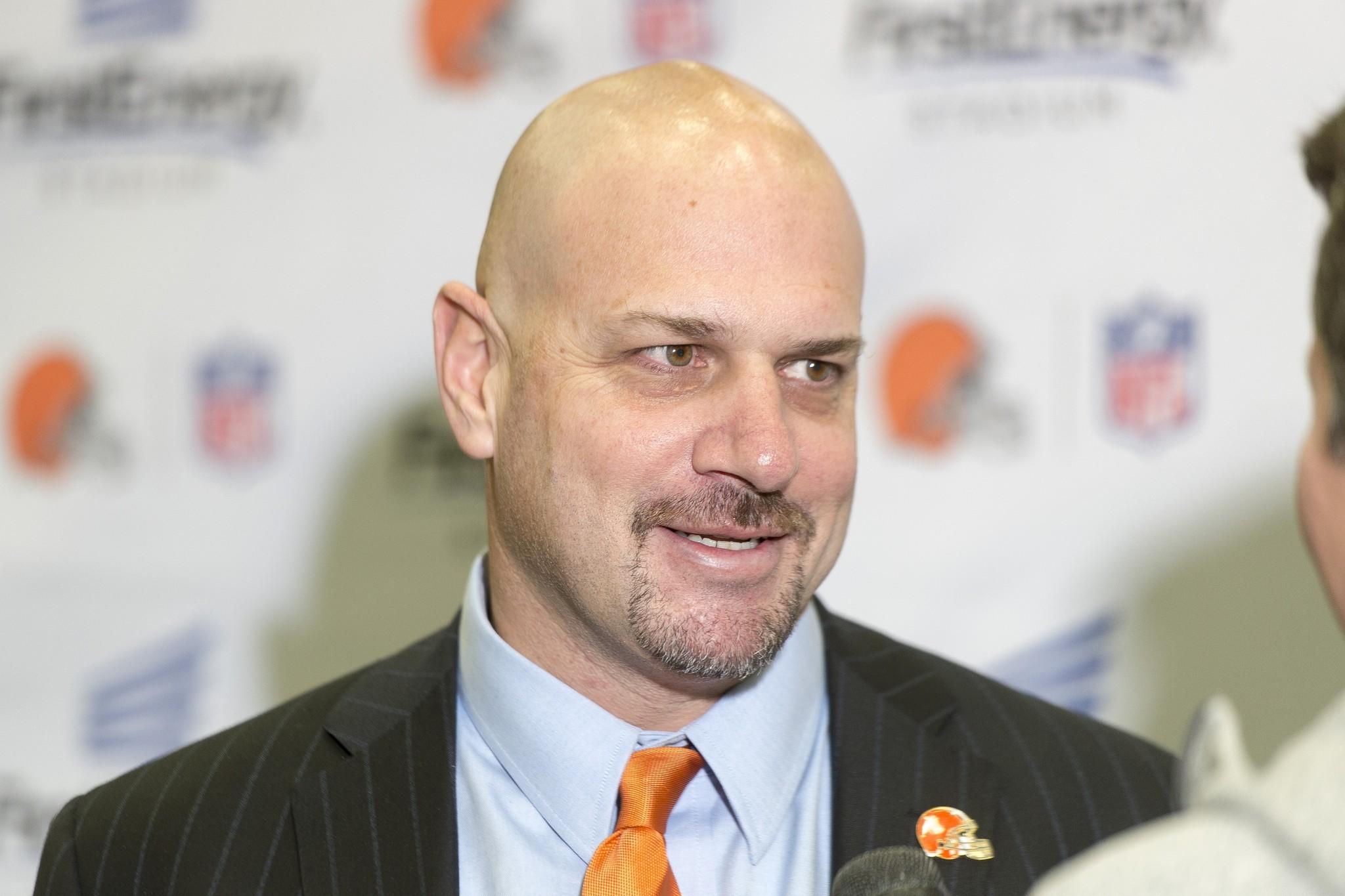 New Browns coach Mike Pettine fields questions from the media during a press conference.