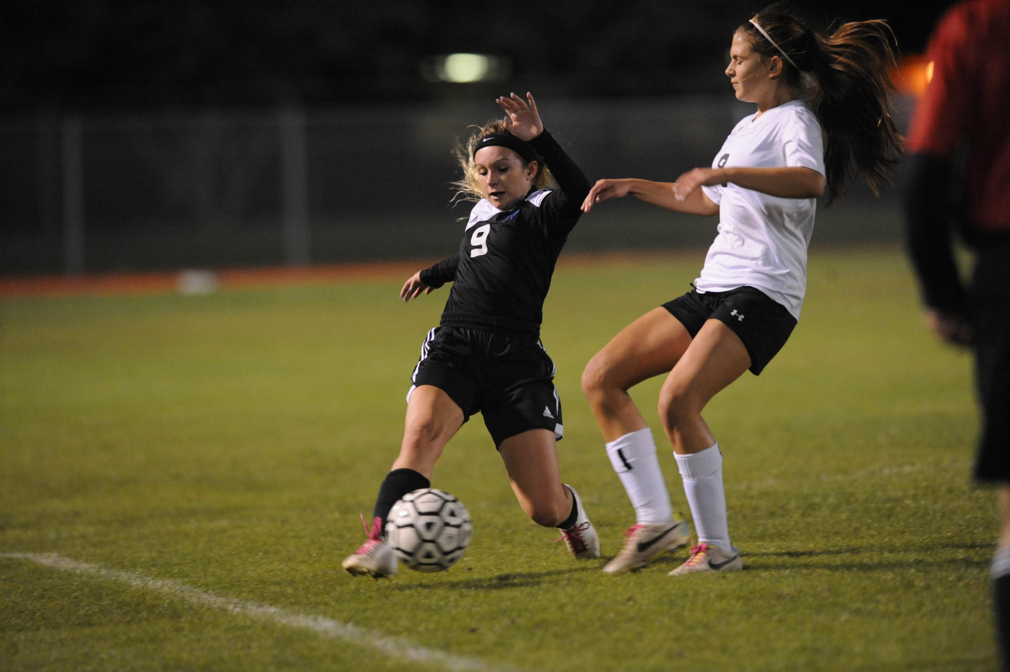 Park Vista's Allyson Weber, left, saves the ball as Douglas' Julia Corin defends in the Class 5A regional quartefinal against host Douglas on Thursday night.