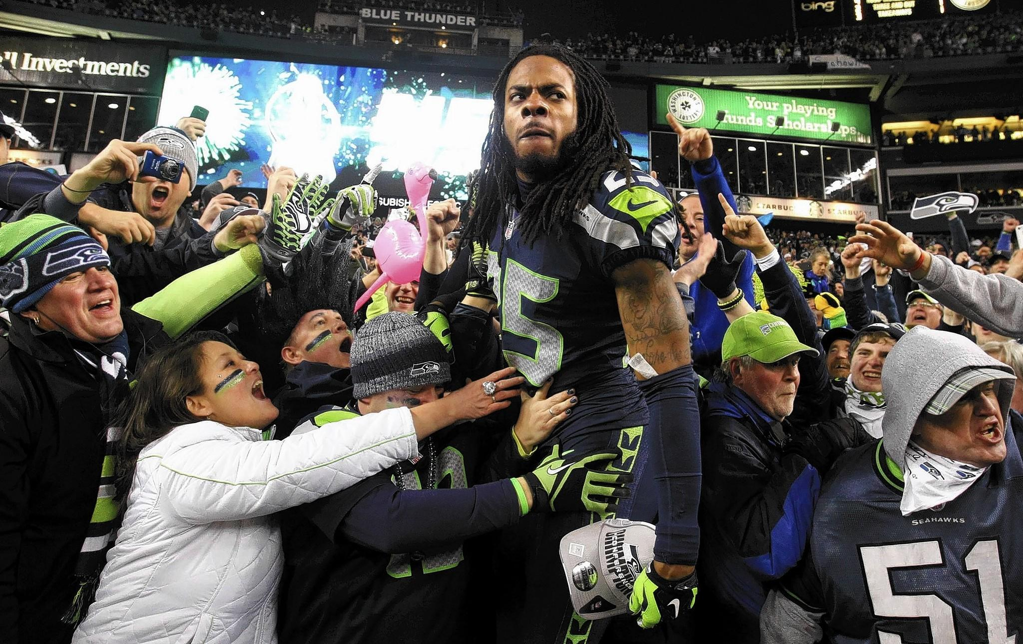 Seattle cornerback Richard Sherman celebrates the Seahawks' victory over San Francisco on Sunday.
