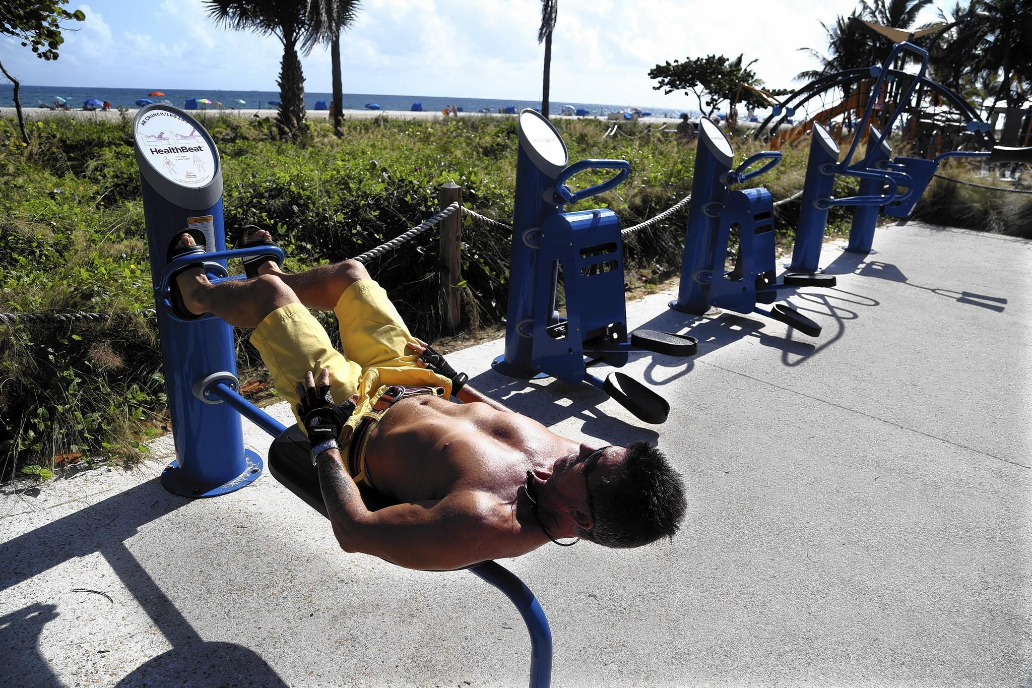 Alexander Giraldo, of Coconut Creek, does ab crunches on one of eight exercise stations at the beach just south of the Pompano Beach Pier.