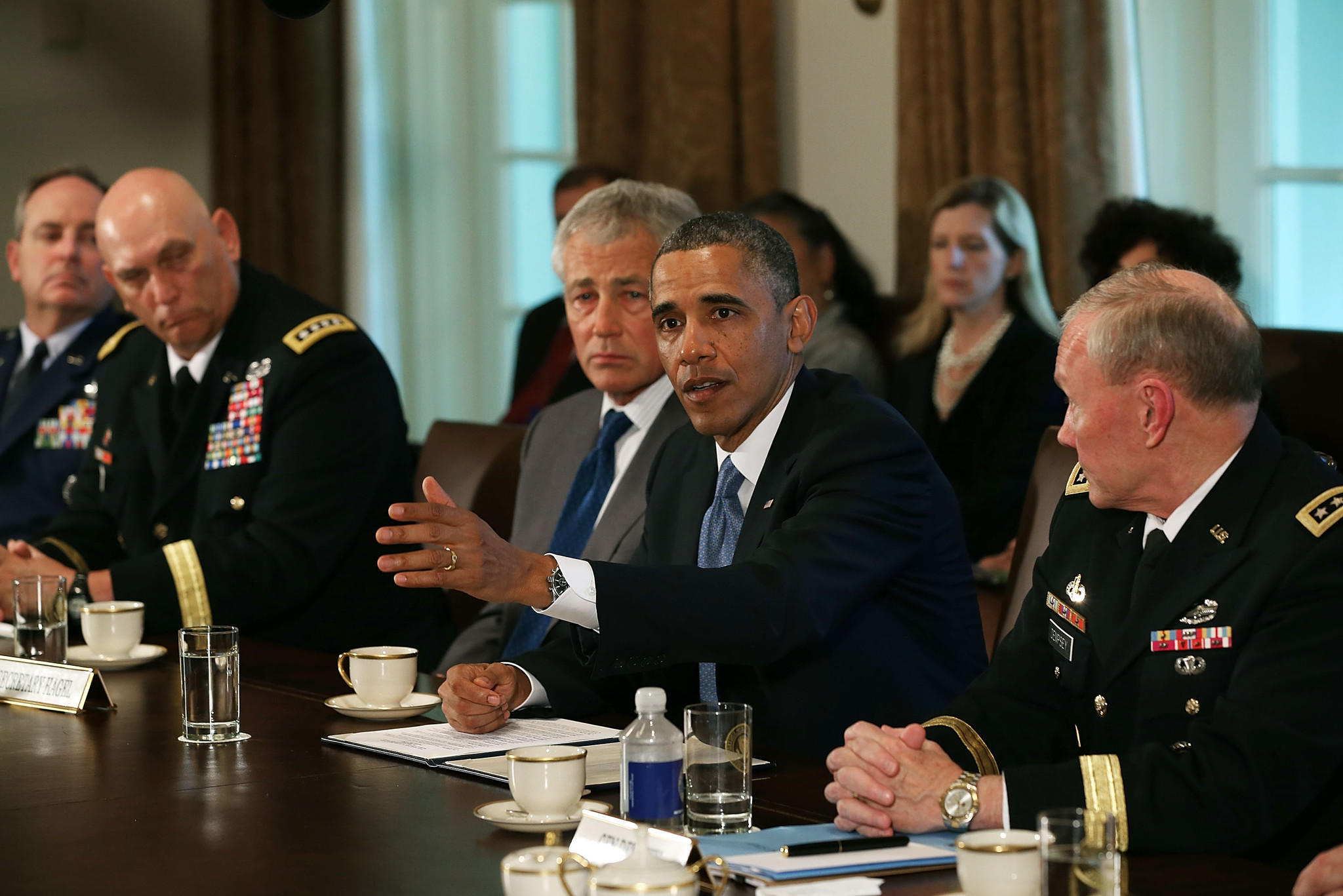 President Barack Obama speaks as Defense Secretary Chuck Hagel (3rd L), U.S. Army Chief of Staff Gen. Raymond Odienaro (2nd L), Air Force Chief of Staff Gen. Mark Welsh (L) and Chairman of the Joint Chiefs of Staff Gen. Martin Dempsey (R) look on during a meeting at the White House in 2013. Obama met with military leaders in the wake of several recent high-profile sex scandals.