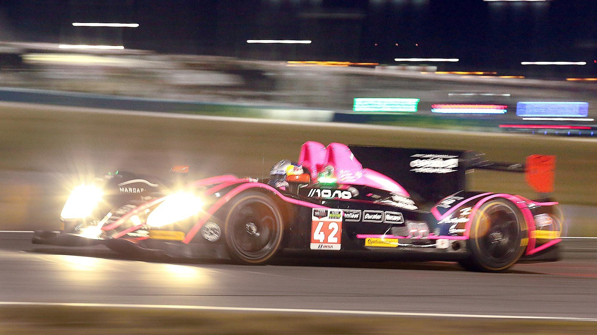 The OAK Racing Morgan race car drives under the lights during practice for the Rolex 24 at Daytona International Speedway on Thursday night, January 23, 2014. (Stephen M. Dowell/Orlando Sentinel)