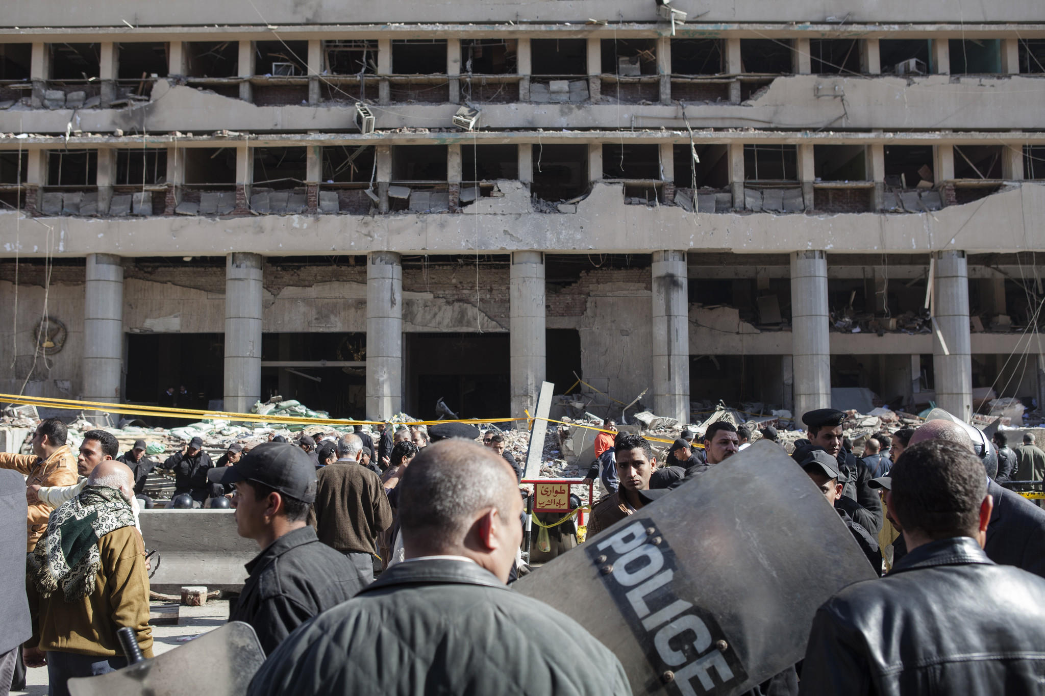 Egyptian security officers stand at the scene of a bomb attack at the Cairo Security Directorate building in the Abdeen district on Jan. 24 in Cairo, Egypt.