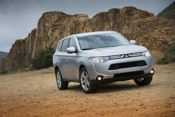 The 2014 Mitsubishi Outlander comes with either a four-cylinder or six-cylinder engine, and standard seating for seven, though adults should avoid the rear seats.