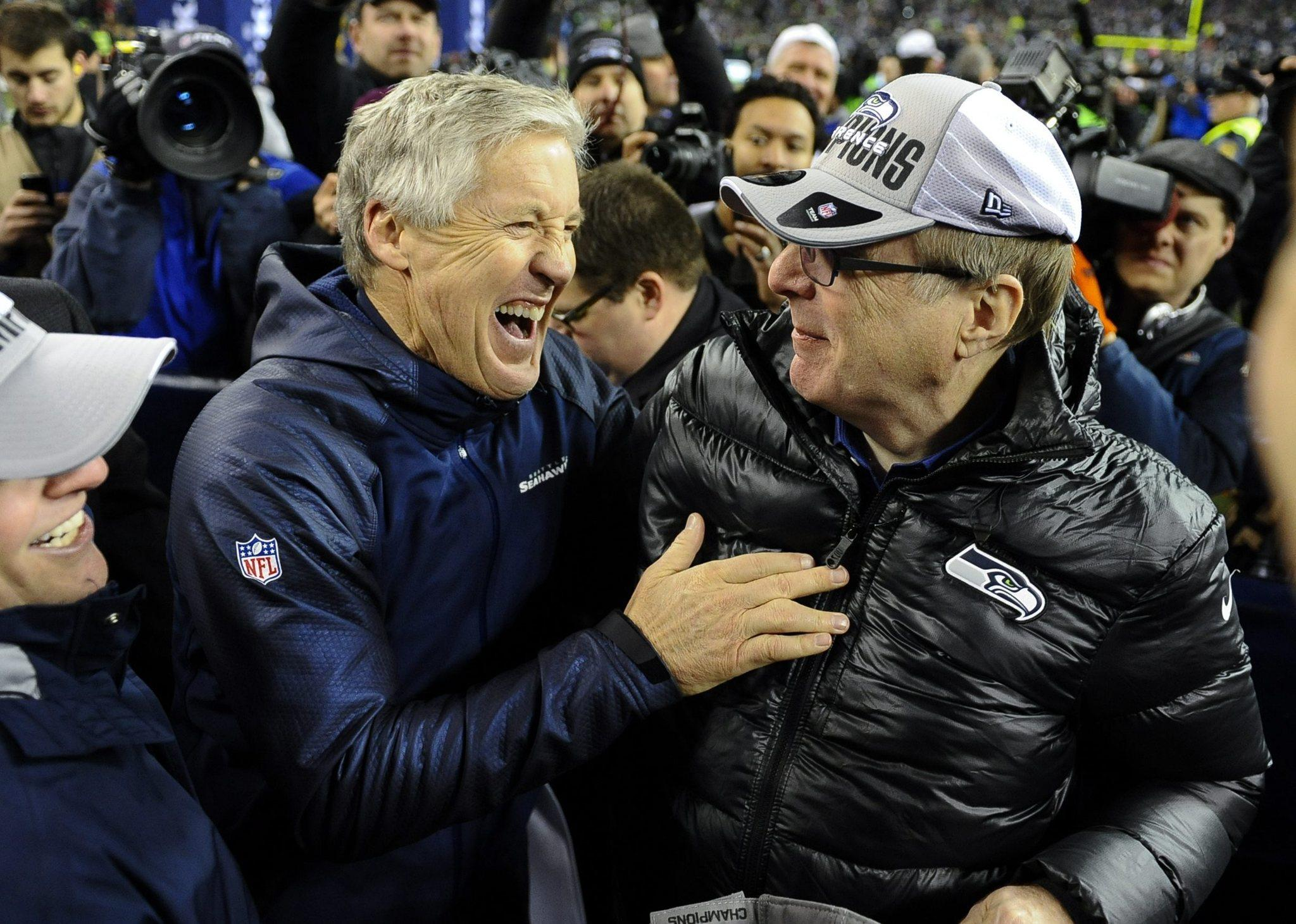 Seahawks head coach Pete Carroll (left) celebrates with Seattle Seahawks owner Paul Allen.