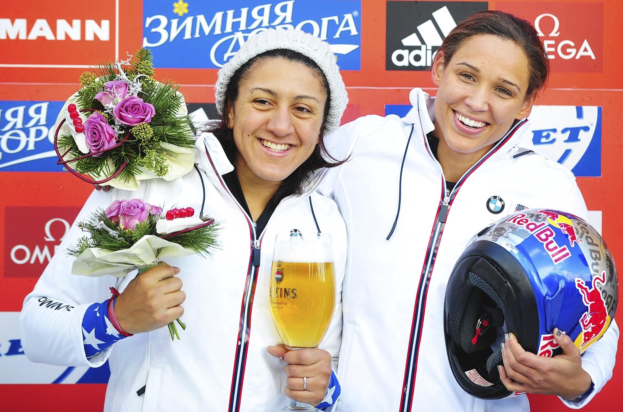 Elana Meyers (left) and Lolo Jones on awards podium after winning a World Cup silver medal in Winterberg, Germany, this month.