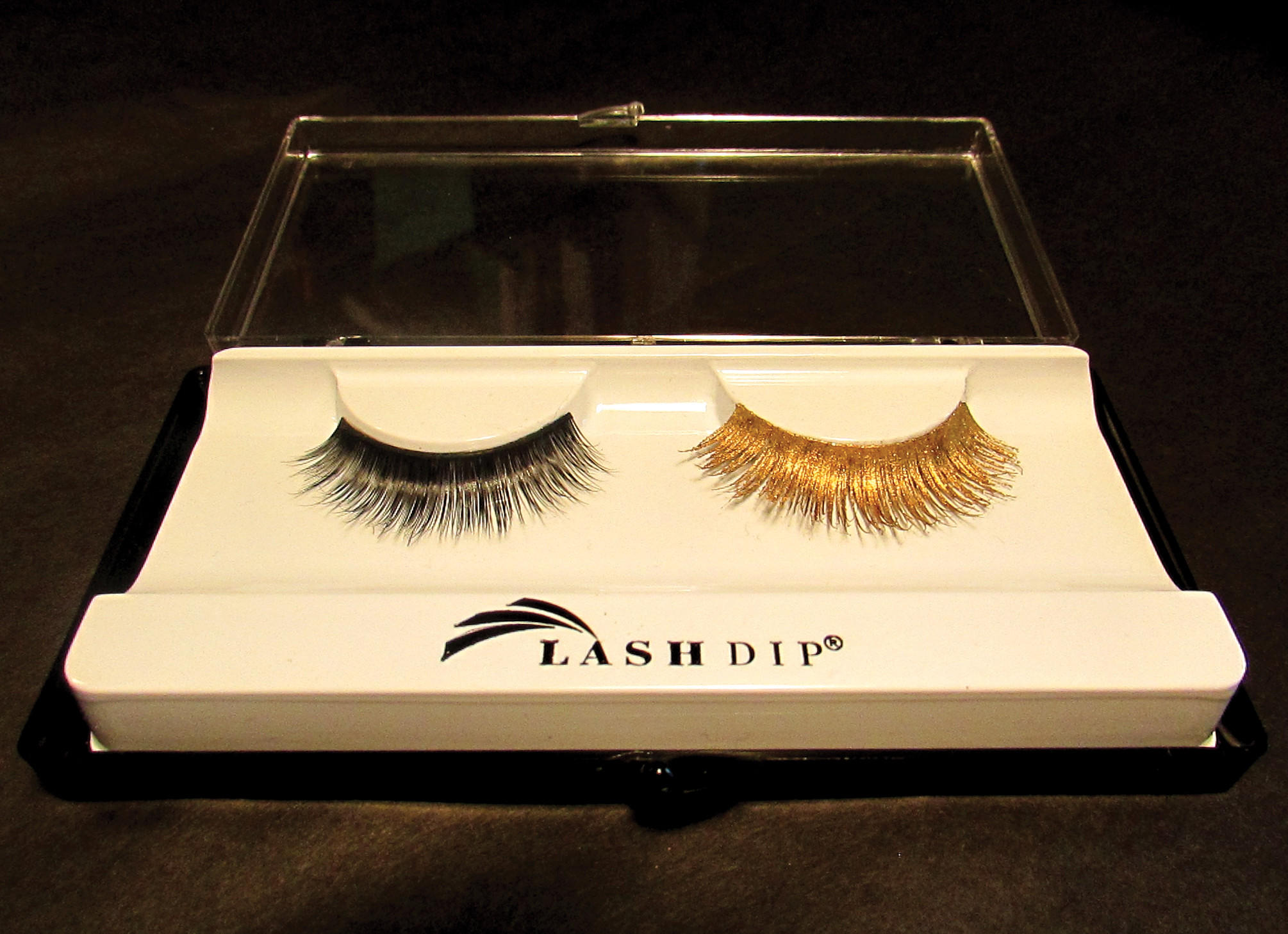A regular lash contrasts with one done in 24-karat gold from Lash Dip.