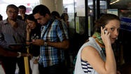 Venezuela sees more airlines suspend ticket sales, demand payment