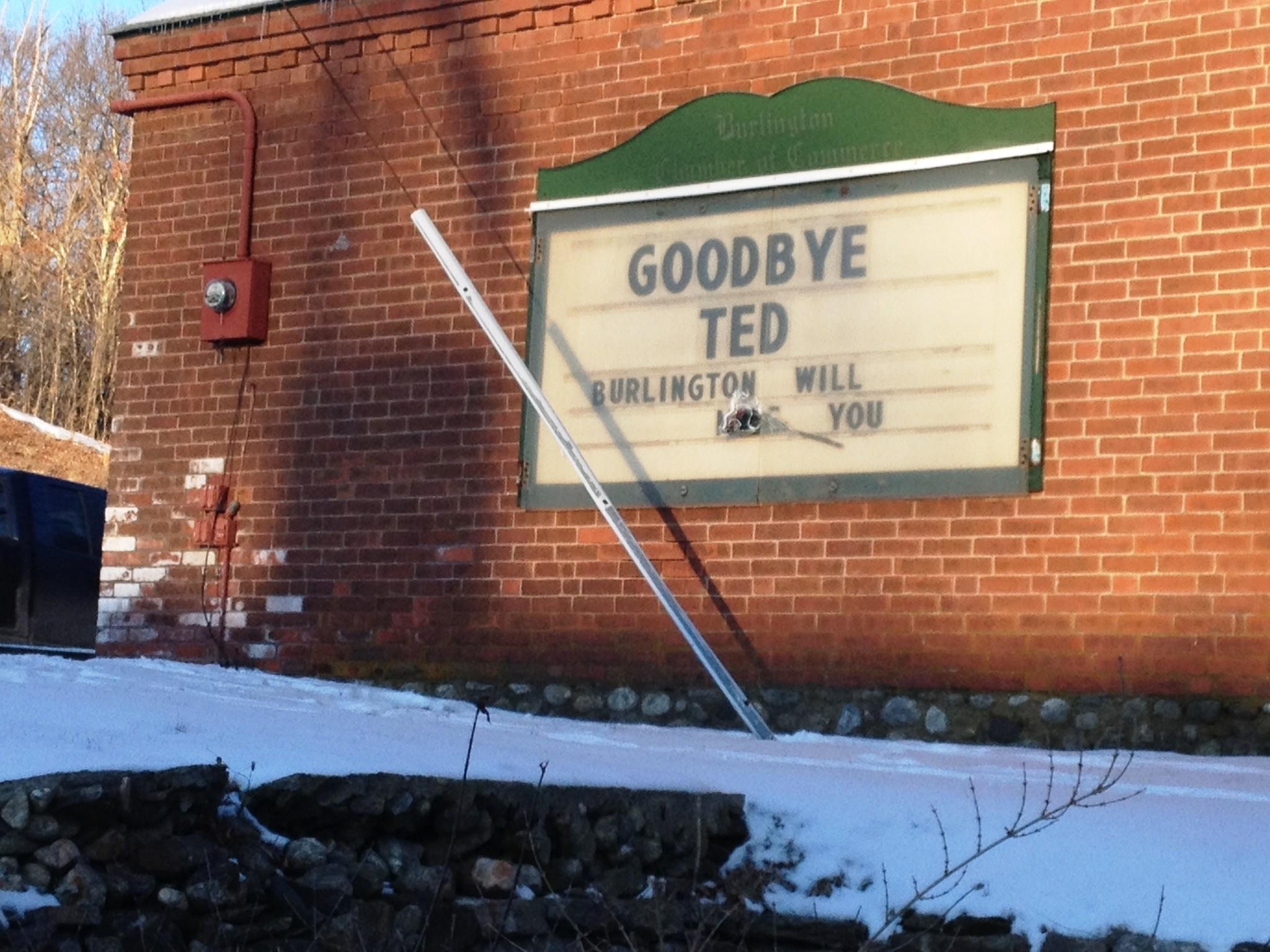 "Usually promoting local events, the Chamber of Commerce sign along Burlington's Route 4 carried a message all week in tribute to former First Selectman Ted Scheidel. A flower covers the word ""miss."""