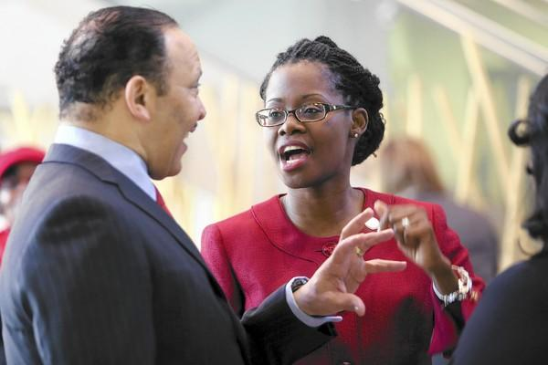 National Urban League President and CEO Marc Morial, left, and Dr. Germaine Smith-Baugh of the Urban League of Broward County speak before a presentation to rally local business and community support for the Urban League's 2015 national conference in Fort Lauderdale.
