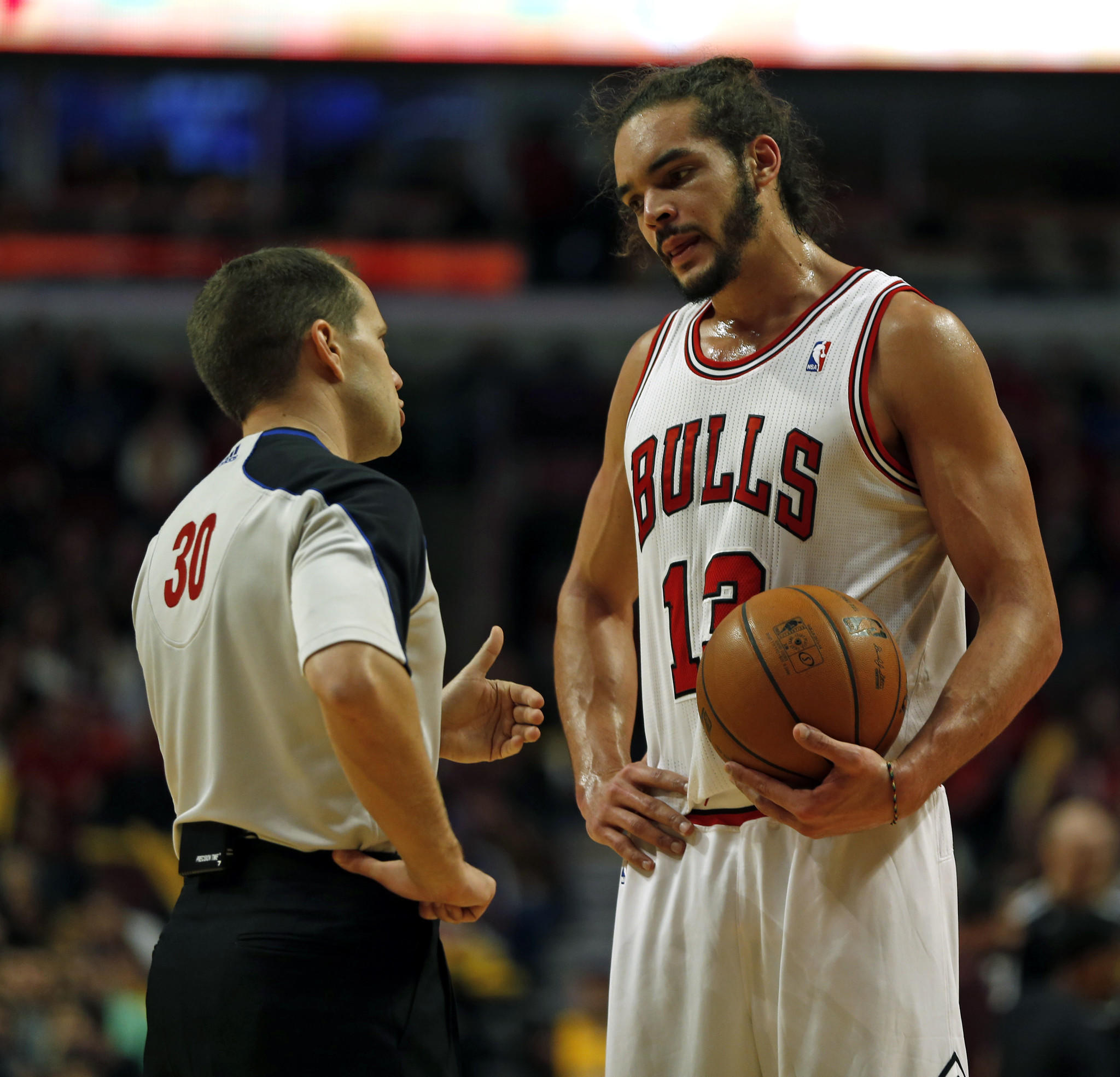 Chicago Bulls' Joakim Noah confers with official John Goble in 2nd quarter of NBA game against Los Angeles Lakers at United Center in Chicago.