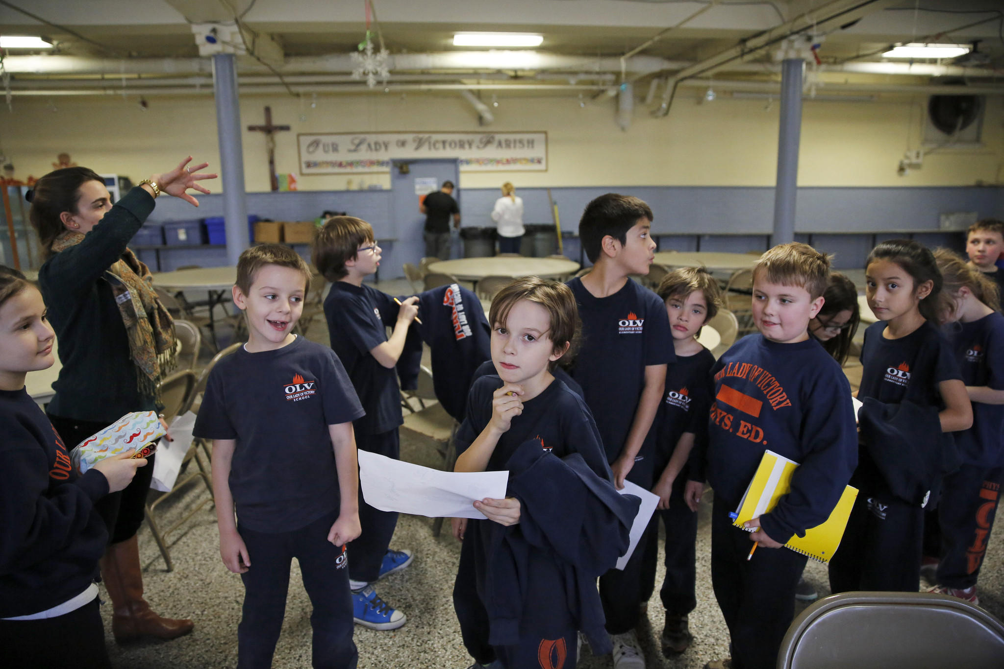 Third grade students walk through the lunch room at Our Lady of Victory in Chicago on Jan. 9. School officials have been told the school may remain open after a fundraising effort. Our Lady of Victor and St. Christopher Catholic School in Midlothian both have been taken off a list of Catholic school slated for closing this year.
