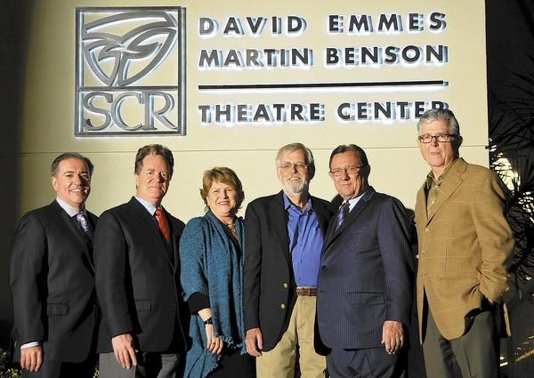 Damien Jordan, president SCR Board of Trustees, Artistic Director, Marc Masterson, Managing Director Paula Tomei, honoree, Martin Benson, Trustee Paul Folino, and honoree David Emmes, pause for a photo under new marquee sign during renaming ceremony at South Coast Reperetory in Costa Mesa on Wednesday.
