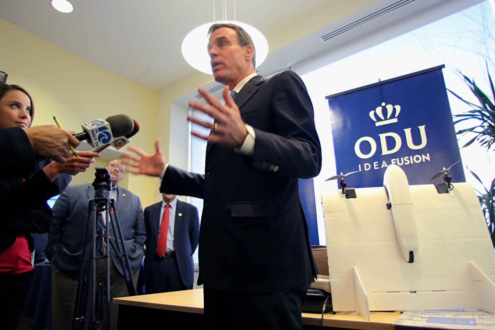 Sen. Mark Warner talks with the press before a meeting to discuss the use of drones in civilian air space on Friday at Old Dominion University.