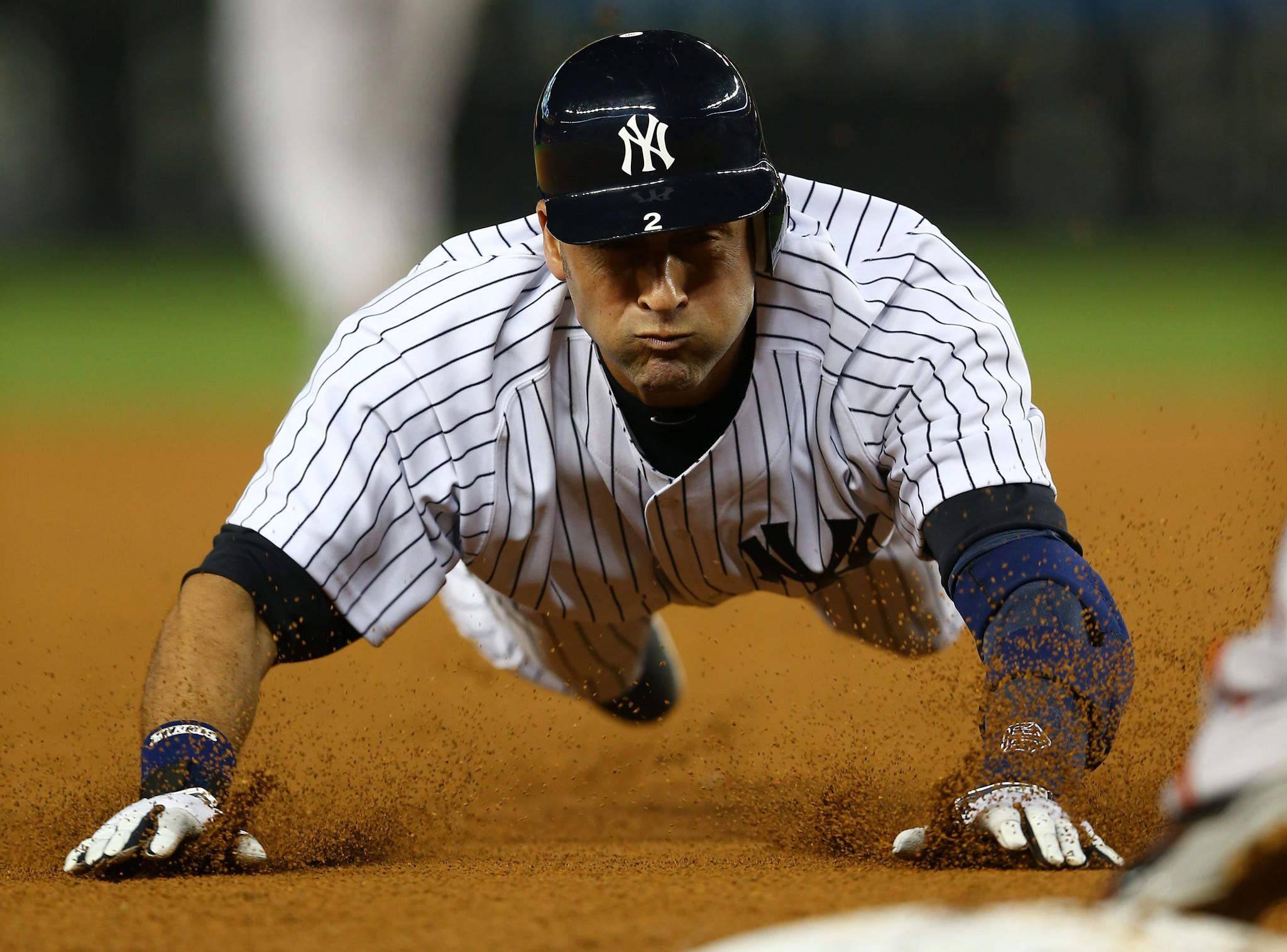 Fox increased its stake to 80% of the New York Yankees' YES regional sports network. Above, Derek Jeter of the New York Yankees slides into third base against the Baltimore Orioles in 2012.