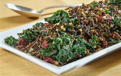 Kale and wild rice salad with raisins and walnuts
