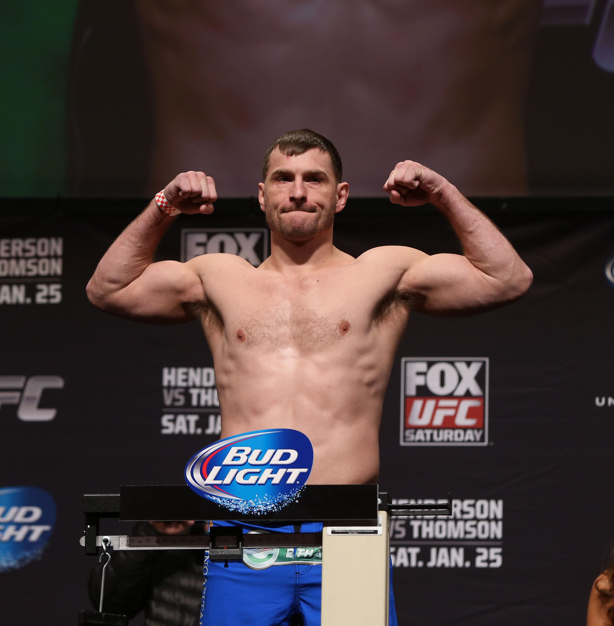 Stipe Miocic steps on the scale at the weigh in at the Chicago Theatre in Chicago on Friday, Jan. 24, 2014, a day before his heavyweight bout at the FOX UFC Saturday event to be held at the United Center in Chicago.