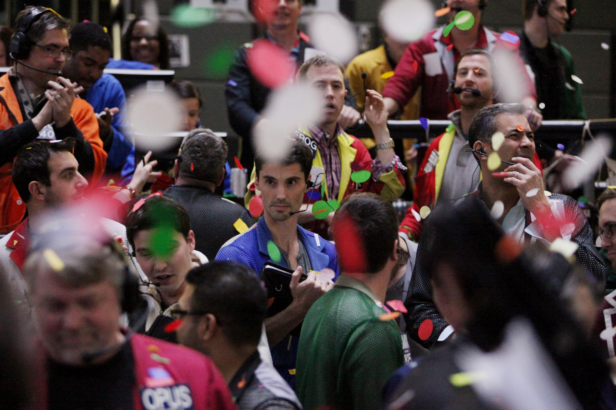 Confetti drops on traders and clerks as they work on the financial floor at the CME Group Inc.'s Chicago Board of Trade in Chicago, Illinois, U.S., on Tuesday, Dec. 31, 2013. U.S.