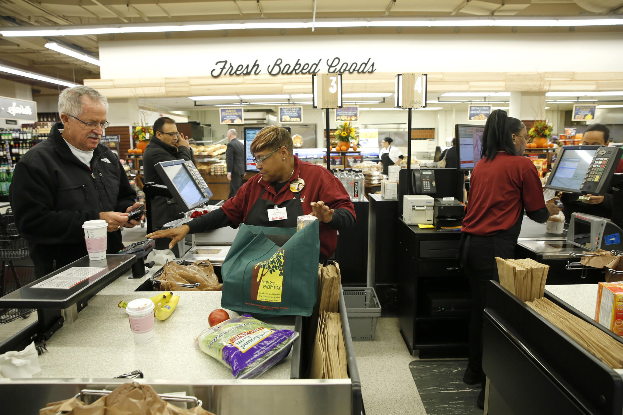 The checkout area has been remodeled. Service clerk Elizabeth Harris checks out Rick Van Horne. The Jewel Osco at State St. and Ohio St. has been remodeled with new features and products.