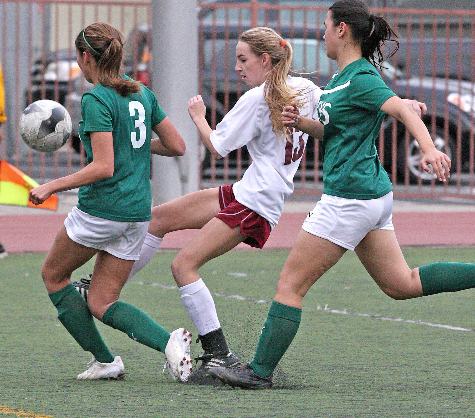 La Canada's Katherine Sheehy makes a goal attempt with Temple City's Alexxis Molinar and Sara Kubo defending during a match at La Cañada High on Friday, January 24, 2014.